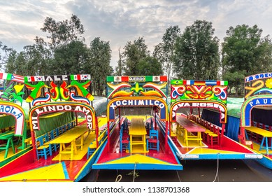 Xochimilco, México City, Mexico: July, 8, 2017: Colorful trajinera boats at canal and chinampa system in Xochimilco, area's pre-Hispanic past in the Valley of Mexico, protected area by UNESCO