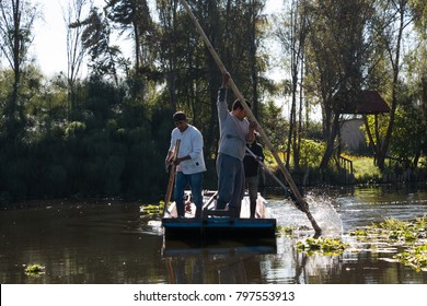 "XOCHIMILCO - MEXICO CITY, DECEMBER 11th 2017: Small group of ""chinamperos"", agriculturists and farmers from Lake Xochimilco, working early morning in the canals"