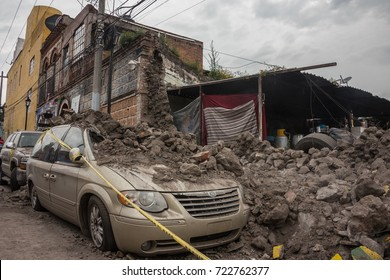 XOCHIMILCO, MEXICO CITY, MEXICO – SEPTEMBER 20, 2017: A building collapsed on vehicles as a result of the earthquake in Mexico on September 19th.