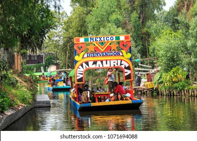 XOCHIMILCO, MEXICO - MAY 20, 2017: Colourful Mexican boats at Xochimilco's Floating Gardens. Xochimilco is a favorite place of leisure for people of Mexico City
