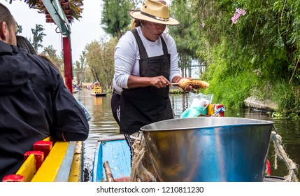Xohimilco, Mexico - Oct 22 2018: vendor selling food on the boat in the Xochimilco canal