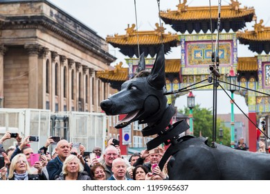 Xolo the giant dog in front of the colourful arch at Liverpool's Chinatown.
