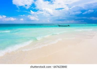 Xpu-Ha Beach - boat at beautiful caribbean coast of Mexico - close to Cancun and Tulum in Quintana Roo - Riviera Maya