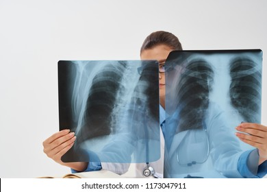 x-ray doctor with glasses in the background