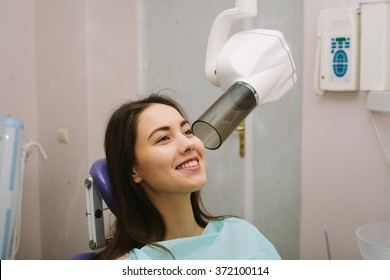 X-ray machine. pretty young woman in a dental office.