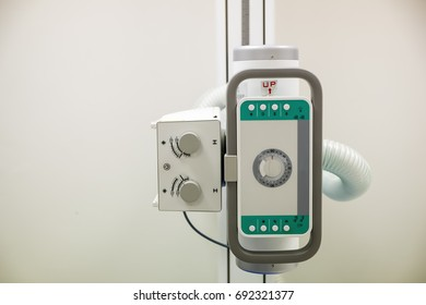 X-ray unit in the hospital, An irradiated radiation emitting device to the patient.Modern medical equipment, interventional medicine and healthcare concept.