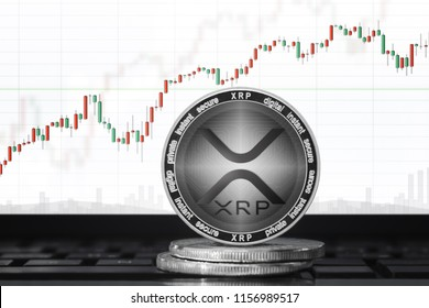 XRP cryptocurrency (new ripple logo); xrp coin on the background of the chart