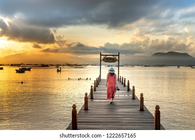 Xuan Dai Bay, Phu Yen province, Vietnam - October 21, 2018: A the happy stylish woman walking at the sunny pier, summer travel concept, the cheerful moment at Xuan Dai Bay, Phu Yen Province, Vietnam