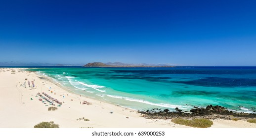 XXL panorama view of the islands of Lobos and Lanzarote seen from Corralejo Beach (Grandes Playas de Corralejo) on Fuerteventura, Canary Islands, Spain, Europe. Beautiful turquoise water & white sand.