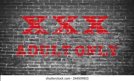 XXX on brick wall.