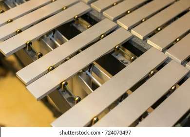 xylophone, musical percussion instruments concept - closeup on glockenspiel, marimba, balafon, semantron, pixiphone, education and orchestra concert usage, beige bars without mallets