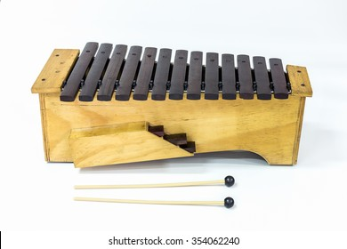 The xylophone and two mallets on the white background