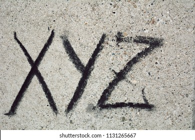 xyz inscription isolated on the grey stone background for design and project management