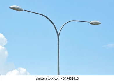 Y shape street lamp pole with blue sky