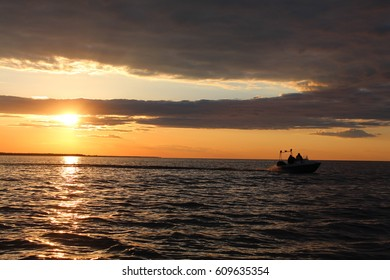 Yacht against sunset.Sailboat.