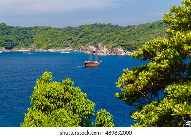 A yacht in a beautiful Bay, rocks, clear sea and blue sky on the island of Koh Similan, the group Similan Islands, Andaman sea, Thailand.