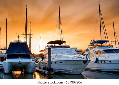Yacht and boats docking at the marina in the evening, Phuket, Thailand