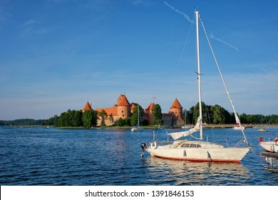 Yacht boats and Trakai Island Castle in lake Galve in day, Lithuania. Trakai Castle is one of major tourist attractions of Lituania