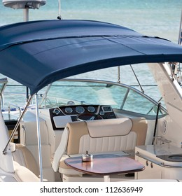 yacht cabin interior with table and dashboard
