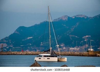 Yacht - catamaran in the evening bay