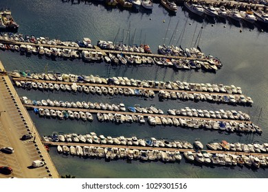 Yacht club, marina with large number of boats, yachts, sailboat and pleasure boats. Boat tour, short sea trip. Mediterranean sea. View from top