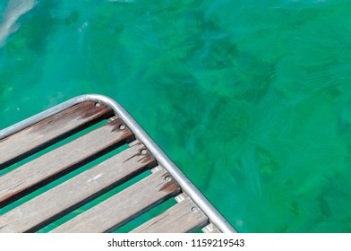 Yacht deck and emerald sea, background