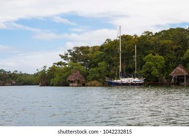 Yacht docked on the shore of Rio Dulce, Guatemala,