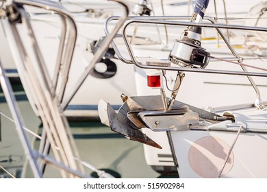 yacht docked in port with anchor chain and winch detail