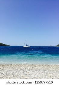 Yacht in front of Panormos beach, Skopelos island, Greece