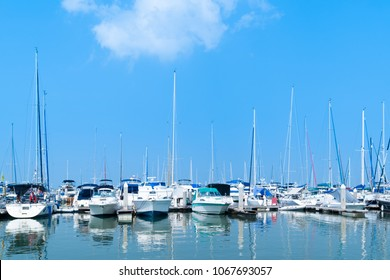 Yacht harbor on blue sky sunset light background, vacation holidays concept yachts in the sea port, luxury summer cruise.