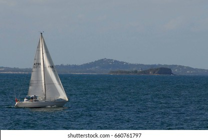Yacht with island in background