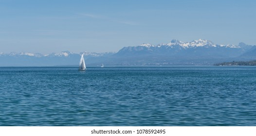 Yacht at the lake Geneva, Switzerland, with the Alps at the background