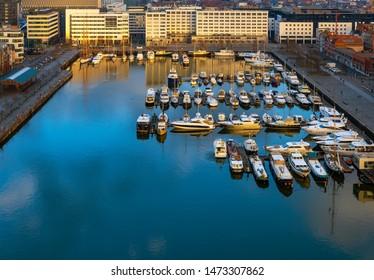 The yacht marina harbor of Antwerpen city (Antwerp in English) at sunset in the Eilandje district, Antwerp Province, Belgium.