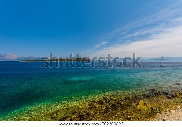 Yacht on azure water. Corfu. Greece.