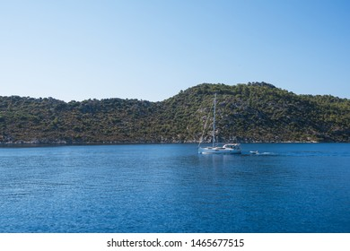 yacht on bay and castle in Kekova, near ruins of the ancient city on the Kekova island, Turkey
