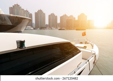 Yacht on huangpu river with Lujiazui skyline, Shanghai, China