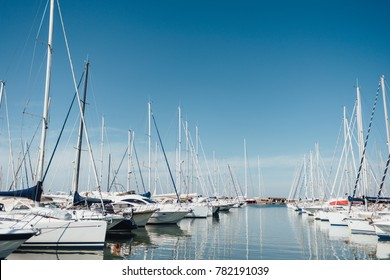 Yacht parking in harbor, harbor yacht club in Marina di Scarlino, Italy. Beautiful Yachts in blue sky background