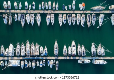 Yacht parking, A marina lot, yachts and sailboats are moored at the quay. Aerial view