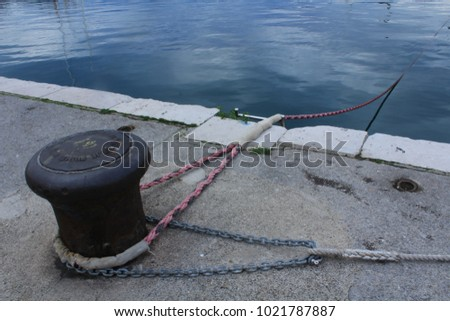 yacht-rope-around-bollard-450w-102178788