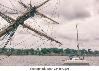 The yacht runs along the river Daugava in Riga