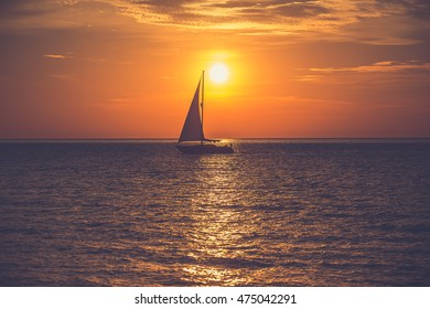 Yacht sailing against sunrise. Holiday lifestyle landscape with skyline. Gdynia Orlowo