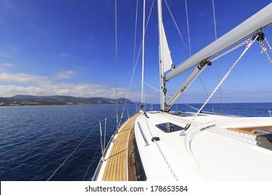Yacht sailing along the coast