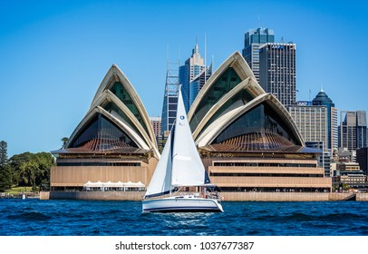 Yacht sailing in front of Sydney Opera House taken in Sydney, NSW, Australia on 25September 2013