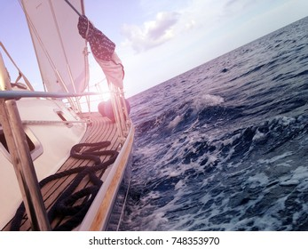 Yacht sailing on the sea, side view,waves, mobile stock