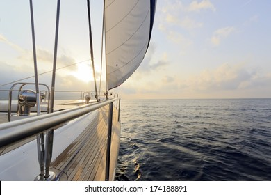 Yacht sailing to the sunset