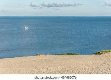 Yacht in the sea near the dunes