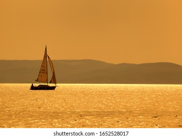 Yacht in the sea at sunset, sailboat and sea