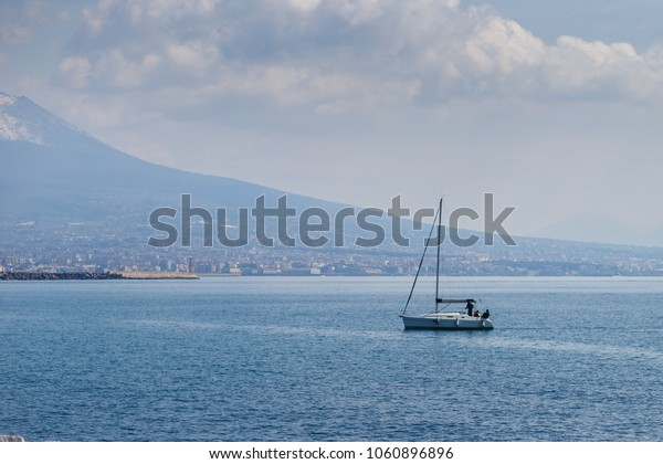 yacht stand still in the water of the gulf of Naples, Italy. Quiet sea and clouds, perfect relaxing day