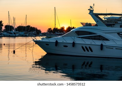 Yacht at sunset background
