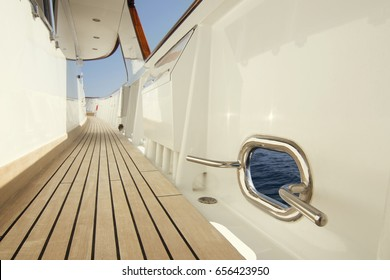Yacht teak deck with opening to the sea.